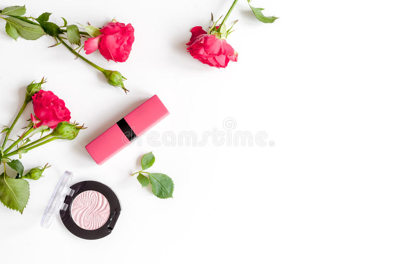 Berry color decorative cosmetics with roses white background top view. Berry color decorative cosmetics with roses on white background top view stock images