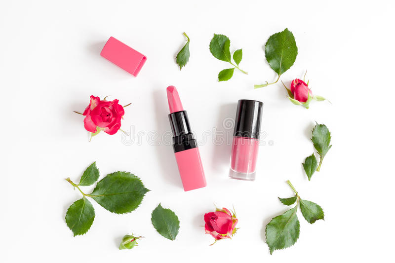 Berry color decorative cosmetics with roses white background top view. Berry color decorative cosmetics with roses on white background top view stock photo
