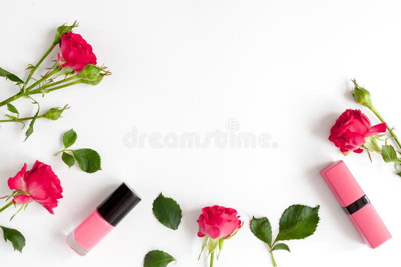 Berry color decorative cosmetics with roses white background top view. Berry color decorative cosmetics with roses on white background top view royalty free stock photography