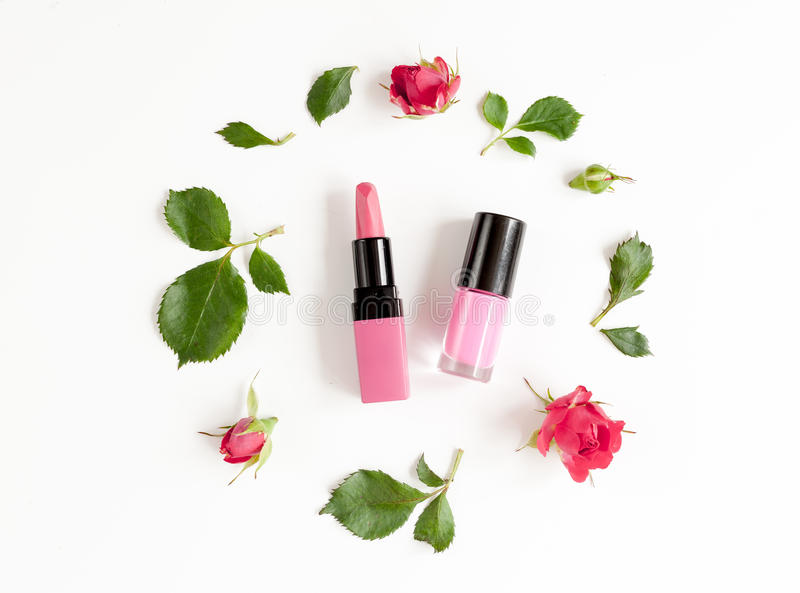 Berry color decorative cosmetics with roses white background top view. Berry color decorative cosmetics with roses on white background top view royalty free stock photos