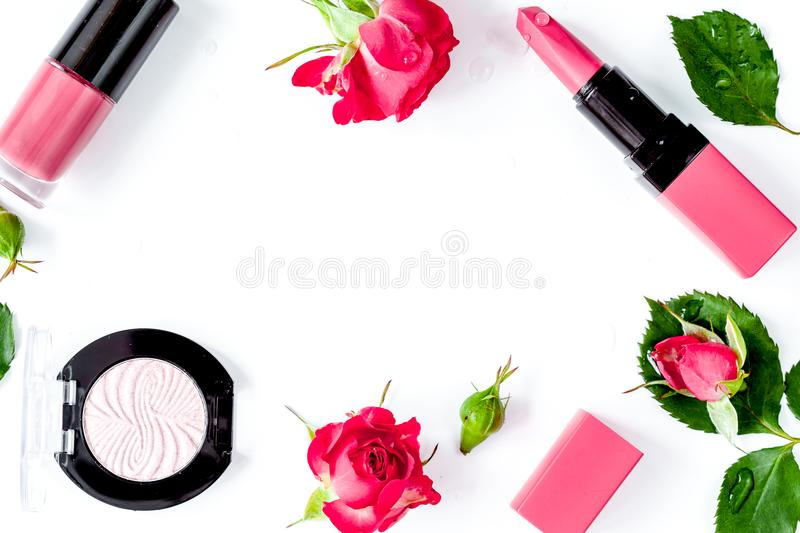 Berry color decorative cosmetics with roses white background top. Berry color decorative cosmetics with roses on white background top view royalty free stock images