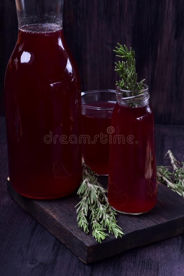Berry compote in glass bottles stock photography
