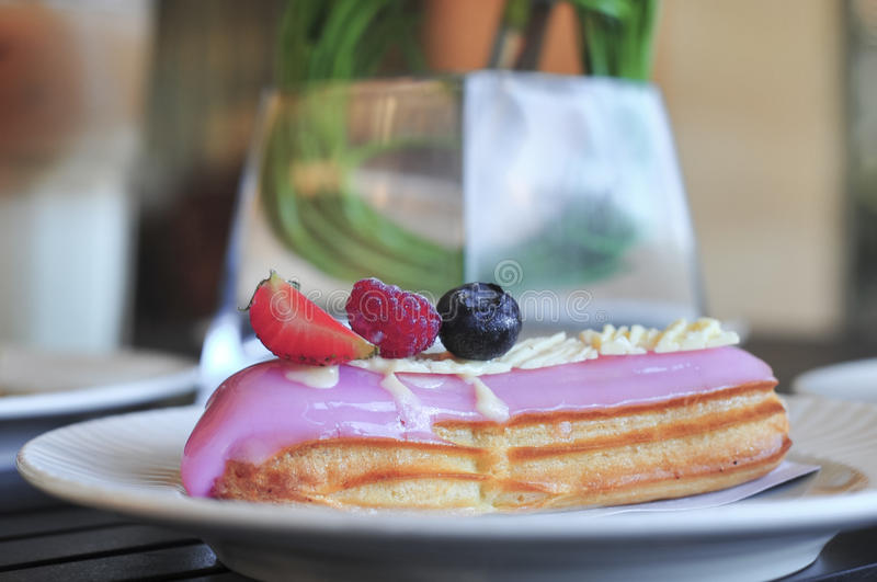 Berry eclair. stock photography