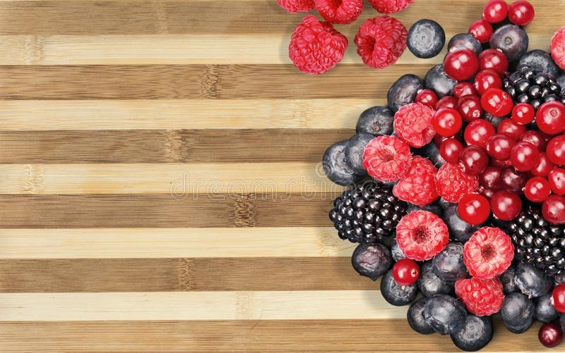 Berry fruit. Blue choice organic blackberry raspberry stock images