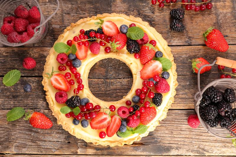 Berry fruit pastry. Delicious berry fruit pastry on wood royalty free stock images