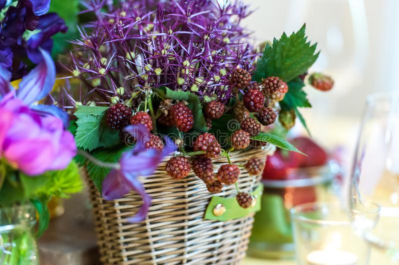 Berry fruits ornament on table in wooden basket stock images