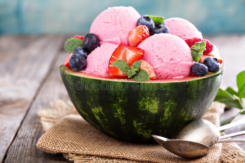 Berry ice cream in a watermelon bowl royalty free stock images