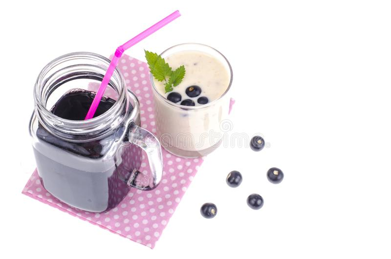 Berry juice and smoothies with yogurt in glass, healthy food royalty free stock image