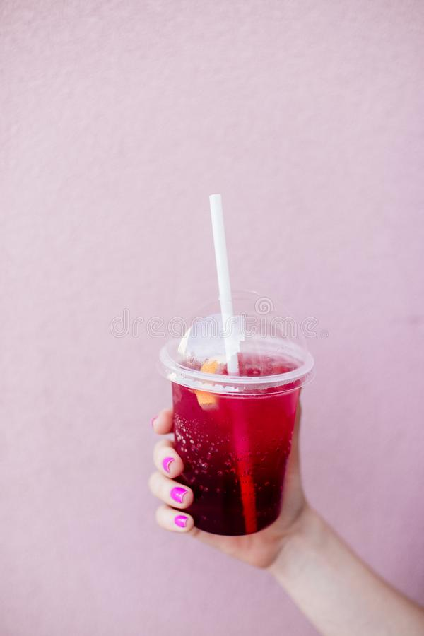 Berry lemonade in the hand. royalty free stock photo