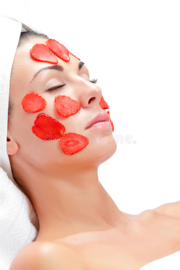 Berry mask. Portrait of young beautiful woman being treated stock photo