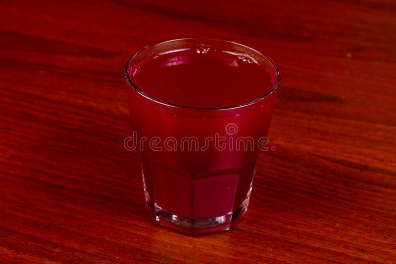 Berry morse drink. Natural Berry morse drink in the glass royalty free stock images