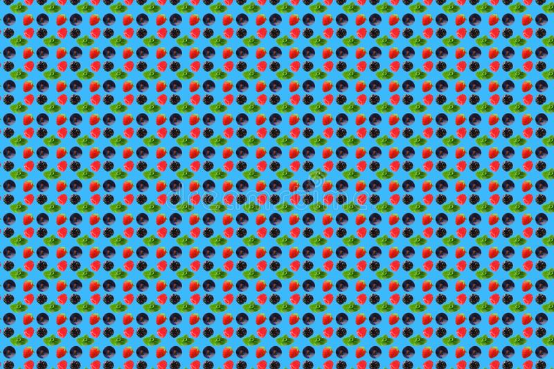 Vivid fruit pattern of fresh berries on colourful background. Berry texture on light blue background. From top view. full depth of field, lifestyle, composition stock image