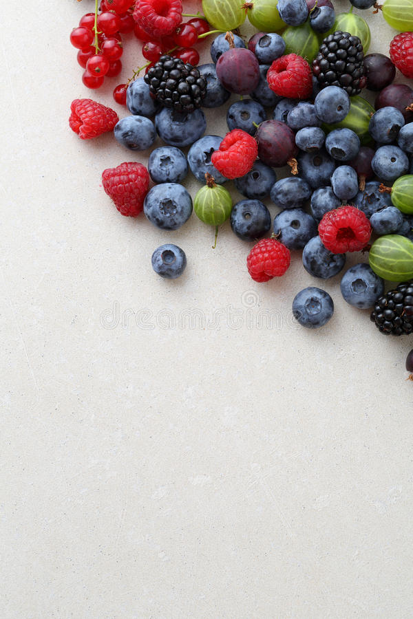 Berry white concrete background. Food top view stock photography