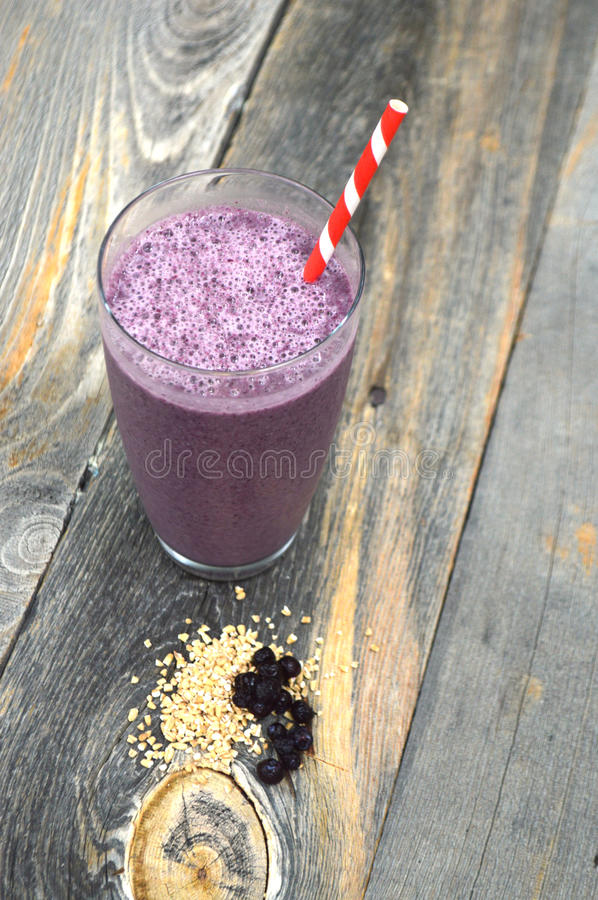 Berryand steel cut oats smoothie on a wood background royalty free stock photos