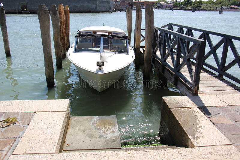 Berth. Wharf - a specially equipped place at the shore for mooring a ship or boat royalty free stock photo