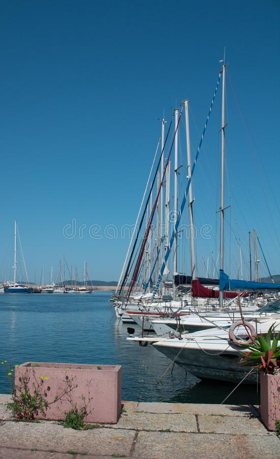 Berth with yachts side view royalty free stock photography
