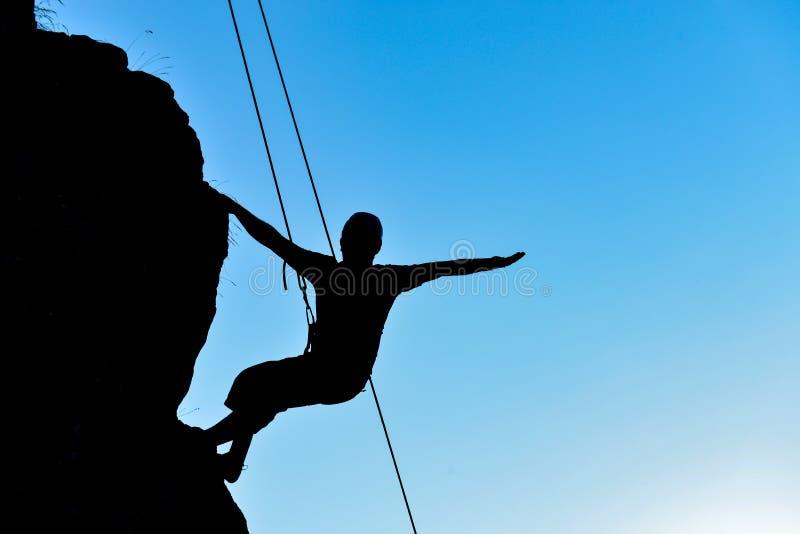 Berufsklettern und verrückter Sportler stockbild