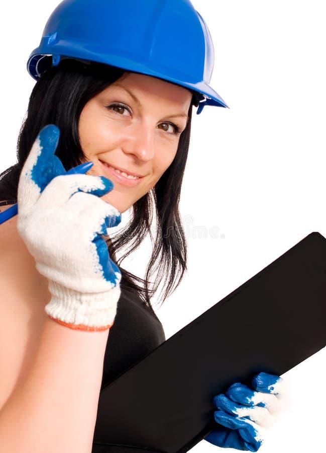 Berufstätige Frau im Sturzhelm lizenzfreie stockfotos