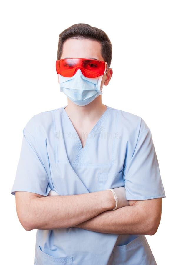 Berufszahnarzt, der überzeugt steht stockfoto