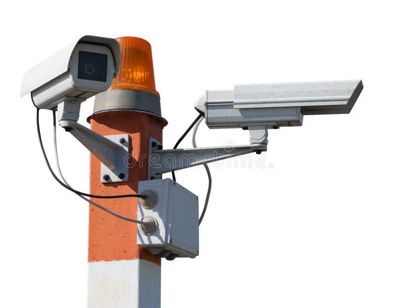 ?berwachungskameras auf S?ule mit Blinklicht stockfotos