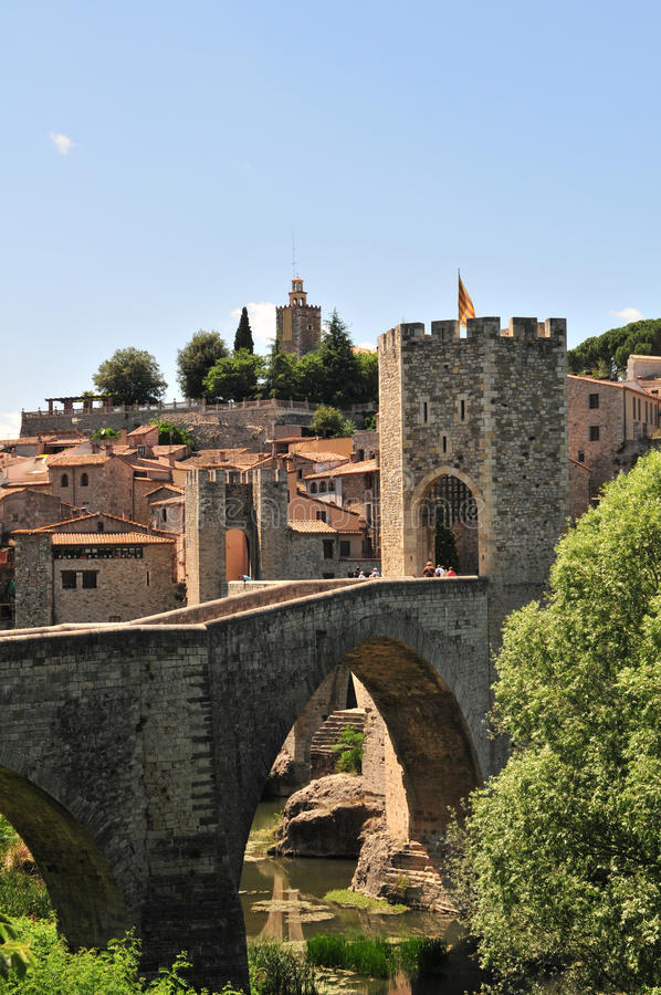 Besalu Medieval bridge. An early-Medieval fortified masonry bridge crossing the river into the town of Besalu royalty free stock photo