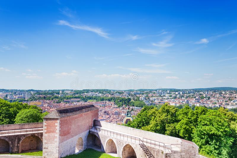 Besancon cityscape with citadel in the foreground. Beautiful cityscape of Besancon with defensive wall and tower of famous citadel in the foreground in summer royalty free stock photos