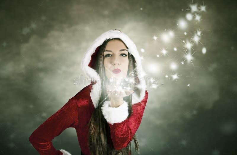Besar la Navidad foto de archivo