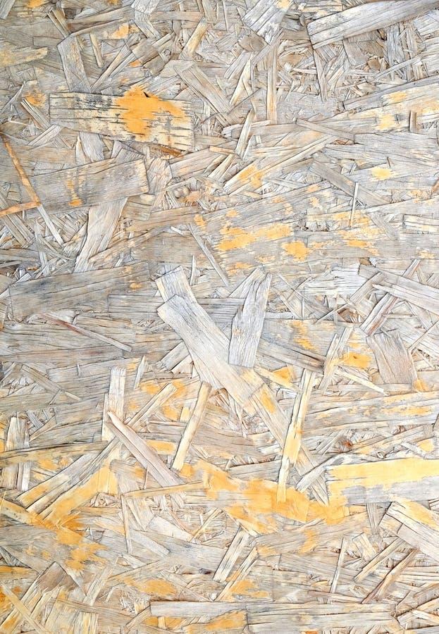 Beschadigde Georiënteerde Bundelraad Houten die paneel van gedrukt zandig bruin schaafsel wordt gemaakt als achtergrondclose-up royalty-vrije stock foto's