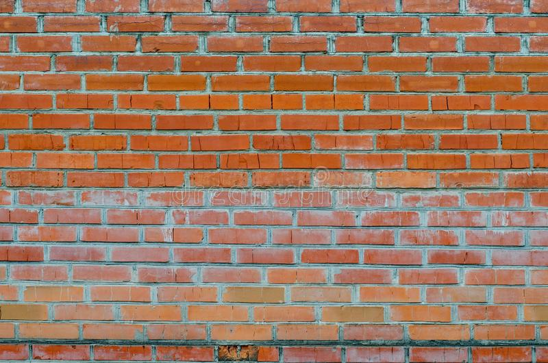 Beschaffenheit der alten Wandoberfläche des roten Backsteins mit Zement- und Betonnähten lizenzfreie stockbilder