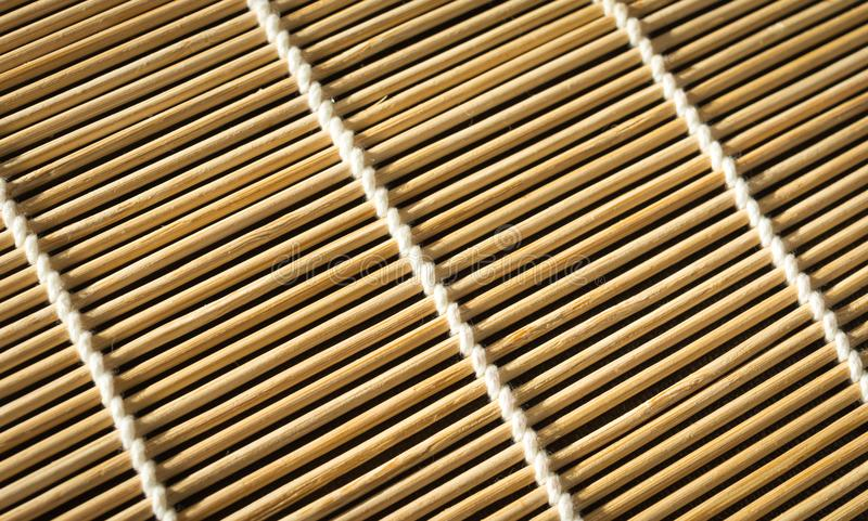 Beschaffenheit der Bambusmatte für Sushi Nahaufnahme Rechteckiger Hintergrund lizenzfreie stockfotografie