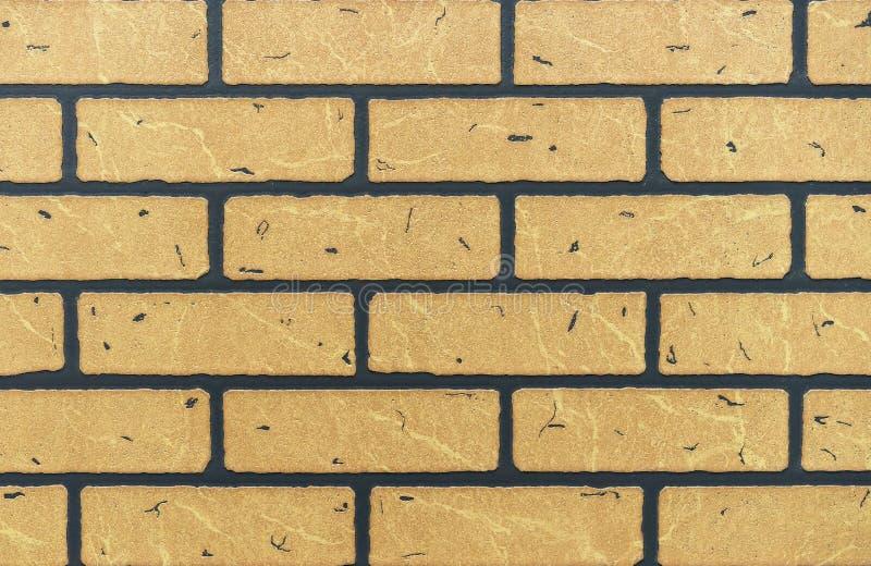 Beschaffenheit der gelben Backsteinmauer für Hintergrund stockfoto