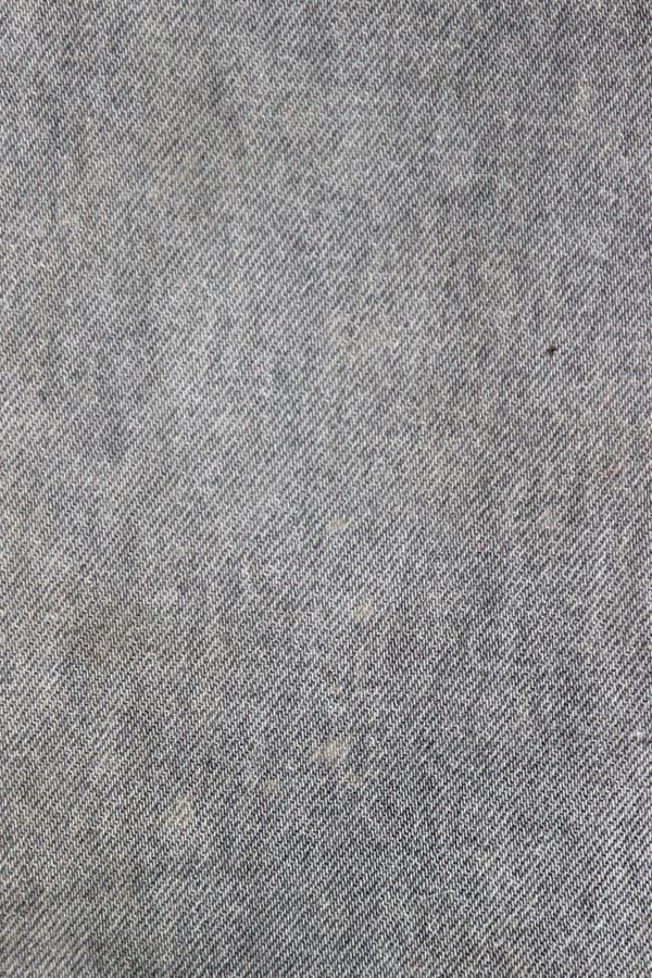 Beschaffenheit der inneren Seite eines grauen Denimgewebes mit Flecken stockfotos
