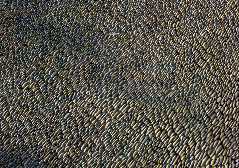 Beschaffenheit der Kieselpflasterung Graue Pflasterung gemacht vom Kiesel stockfotografie