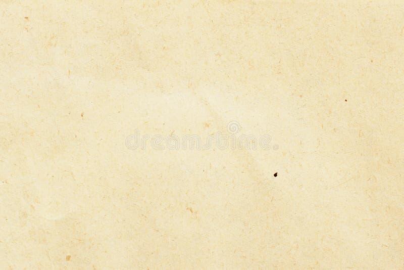 Beschaffenheit des ökologischen beige Papiers, Hintergrund für Design mit Kopienraumtext oder Bild Wertstoff, hat kleines lizenzfreie stockfotos