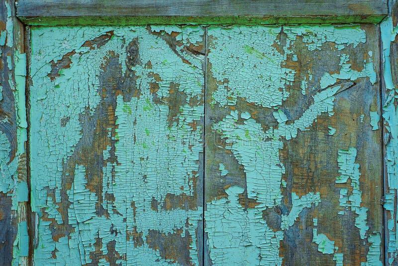 Beschaffenheit des alten rostigen Holzes, gemaltes Blau mit Stellen der ersten hölzernen Schicht stockfoto