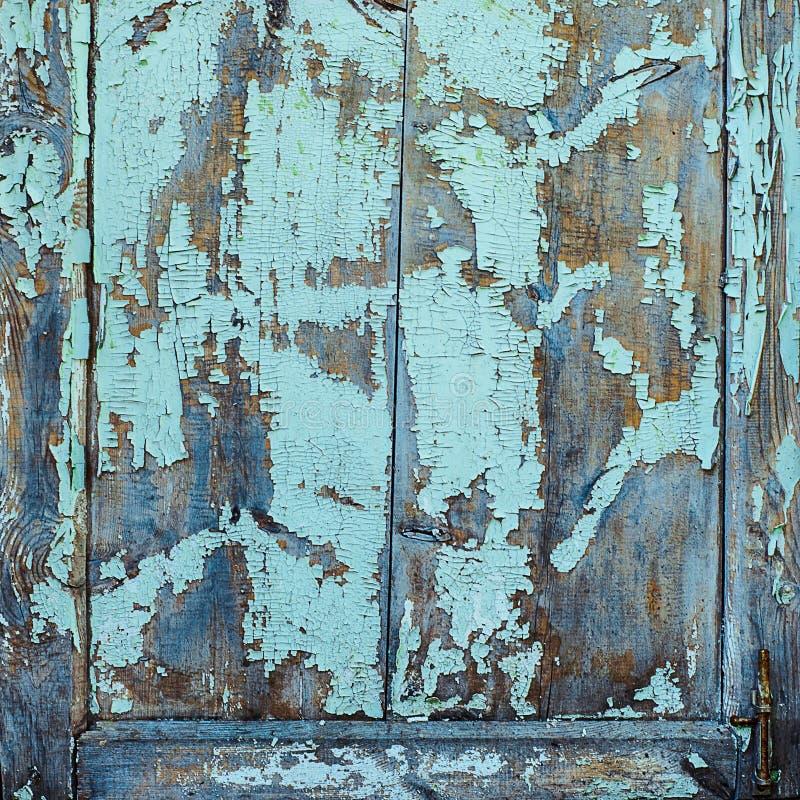 Beschaffenheit des alten rostigen Holzes, gemaltes Blau mit Stellen der ersten hölzernen Schicht stockfotos