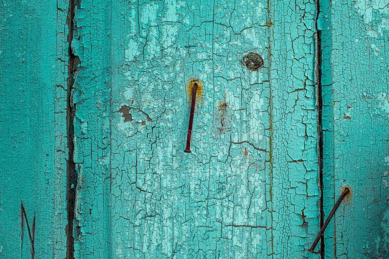 Beschaffenheit des alten rostigen Holzes, gemaltes Grün mit Stellen der ersten dunklen Schicht lizenzfreies stockfoto