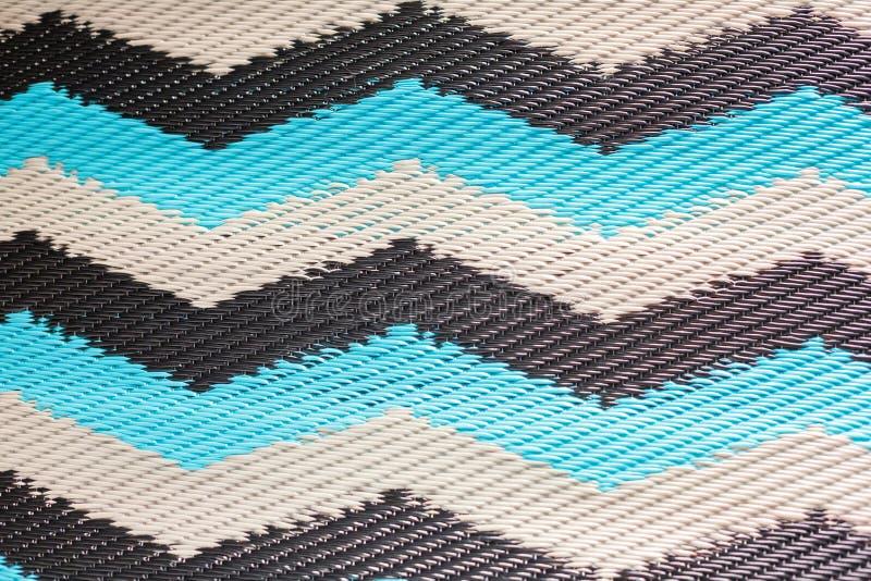 Beschaffenheit des gesponnenen Teppichs hergestellt vom Plastik lizenzfreie stockbilder
