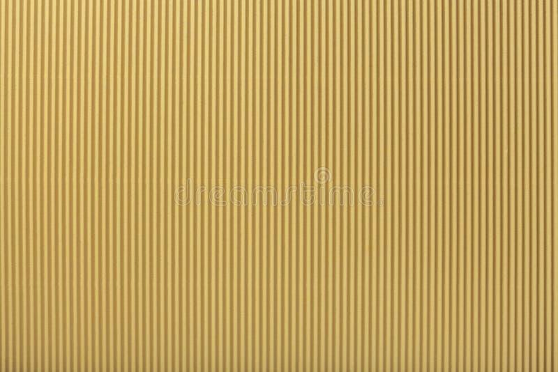 Beschaffenheit des gewölbten hellen goldenen Papiers, Makro lizenzfreie abbildung