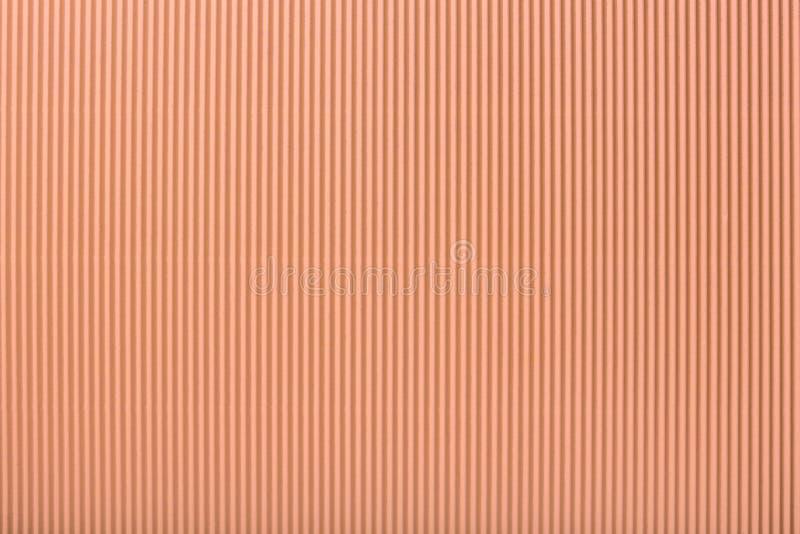 Beschaffenheit des gewölbten hellen korallenroten Papiers, Makro lizenzfreie abbildung