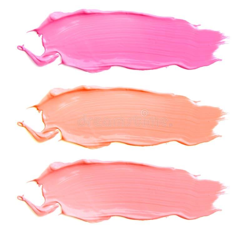 Beschaffenheit des Lippenstifts der verschiedenen Farben lokalisiert auf weißem Hintergrund Satz mehrfarbige Anschläge Kosmetisch lizenzfreie stockfotografie