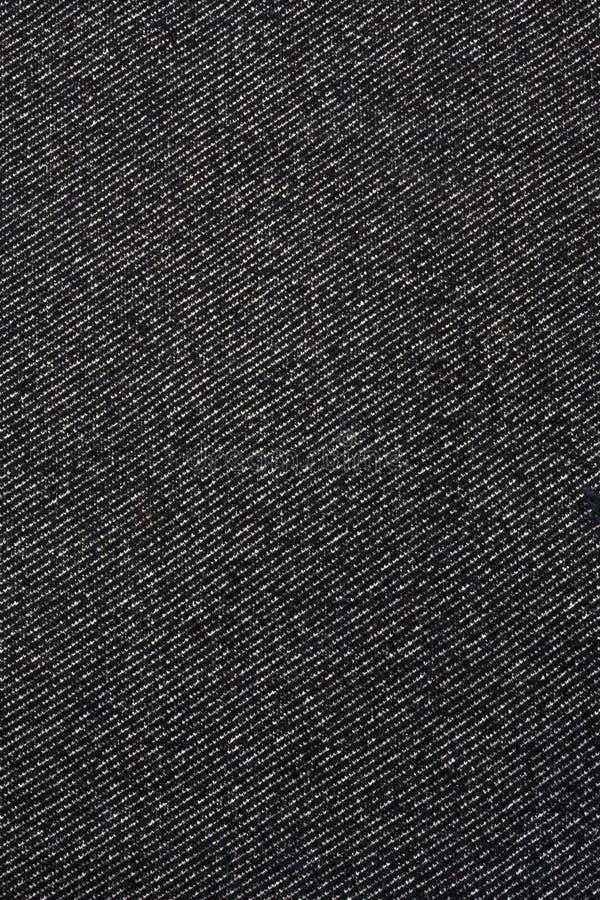 Beschaffenheit des schwarzen Jeansgewebes stockfoto