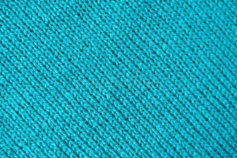Beschaffenheit des Türkis-Blau-farbigen Alpakas strickte Wollgewebe in den diagonalen Mustern stockbilder