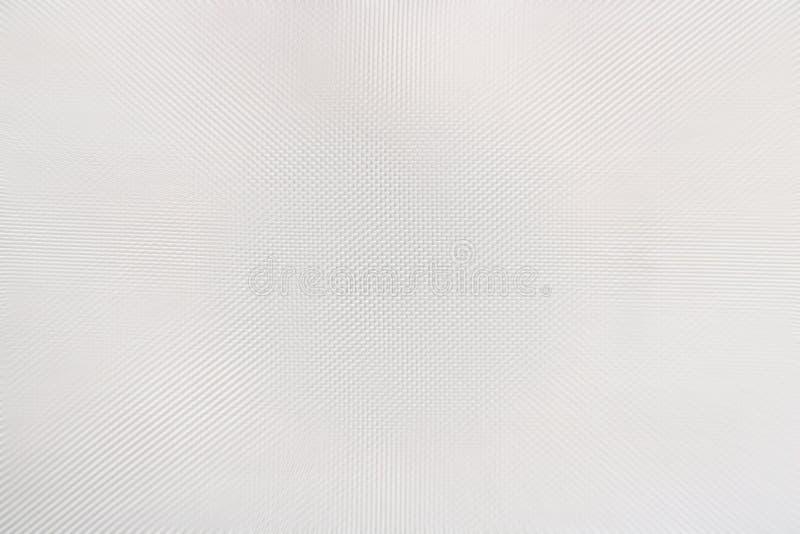 Beschaffenheit des weißen Plastiks mit materiellen Flockenstückchen, abstrakter Musterhintergrund, selektiver Fokus lizenzfreie stockfotos