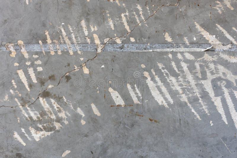 Beschaffenheit einer alten grauen Zementwand mit Kratzer und Fleck lizenzfreies stockfoto