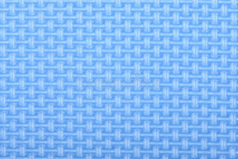 Beschaffenheit einer Glanz-Turnhallenmatte des Polyäthylens blauen Yogamattenbeschaffenheit stockfotografie