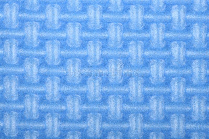 Beschaffenheit einer Glanz-Turnhallenmatte des Poly?thylens blauen Yogamattenbeschaffenheit lizenzfreie stockfotografie