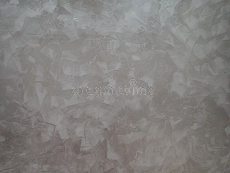 Beschaffenheit eines grauen Stucks auf einer Wand stockfotografie