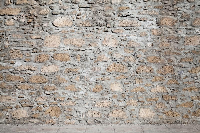 Beschaffenheit eines rauen Steinwand und Boden Tiling stockfoto
