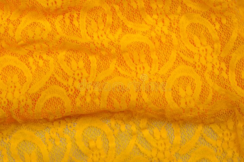 Beschaffenheit, Gewebe, Hintergrund Lacy Yellow-Gewebe, Spitze Ein dünnes OP lizenzfreie stockbilder
